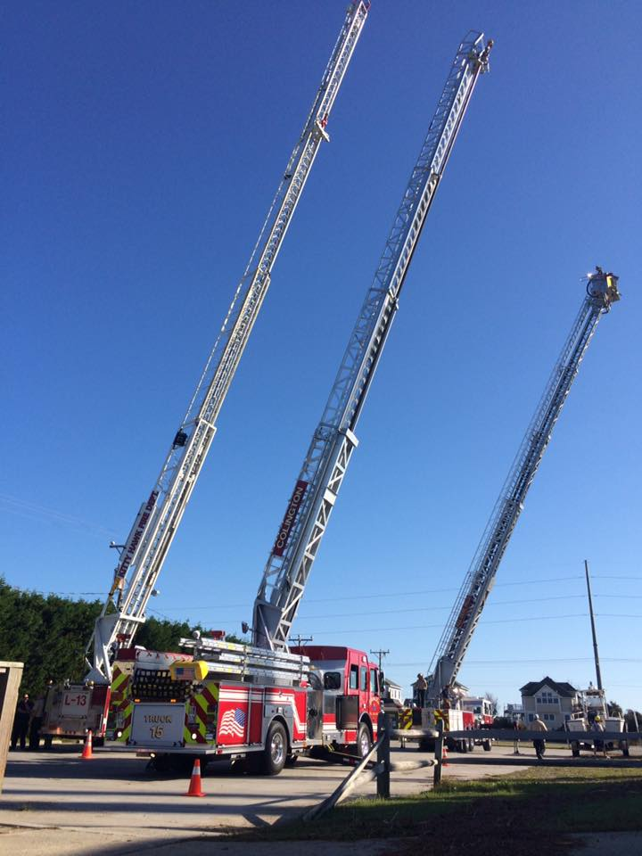 Colington Truck 15 (foreground), Kitty Hawk Ladder 13 (left) and Kill Devil Hills Truck 14 in operation during training classes.